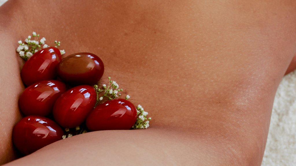 Naked woman with Bloodstone Yoni Egg