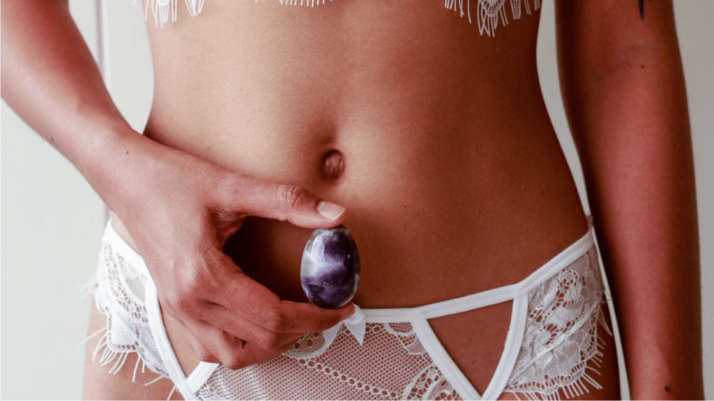 Sexy woman in white with Amethyst Yoni Egg