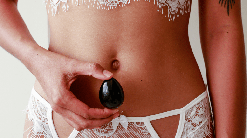Sexy woman in white with Black Obsidian Yoni Egg