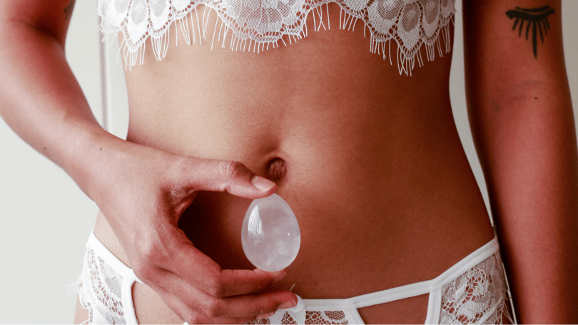 Sexy woman in white with Moonstone Yoni Egg