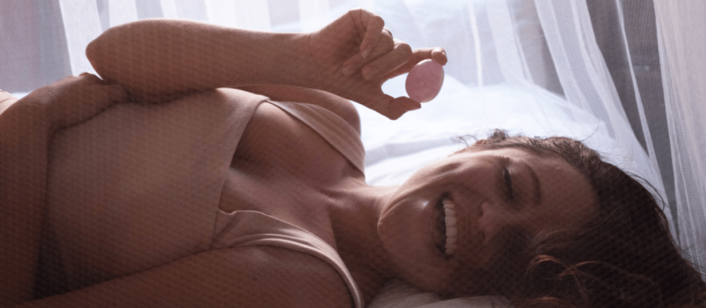 beautiful happy woman with Rose Quartz Yoni Egg