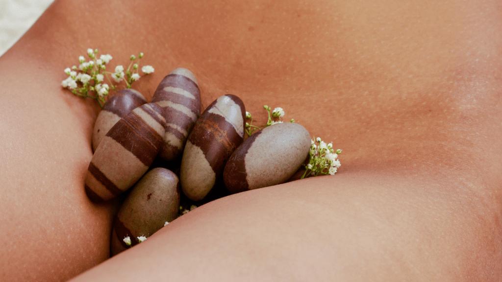 naked woman with Shiva lingam yoni eggs